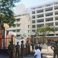 Security guards Monday stand in front of a hospital in Colombo where Japanese victims of Sunday's terrorist attacks are believed to have been taken to. | KYODO