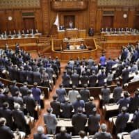 The Lower House passes a bill to prohibit drone flights over Self-Defense Forces and U.S. bases, as well as venues for the 2020 Tokyo Olympics and Paralympics, on Tuesday. | KYODO