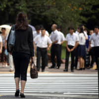 Women increased their roles in the workforce during the Heisei Era but their share of leadership roles remains low. | BLOOMBERG