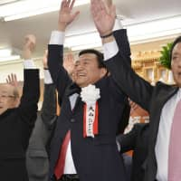Hideto Onishi (center), celebrates with supporters on Sunday in Takamatsu, Kagawa Prefecture, after winning uncontested his fourth term as the mayor of the city. He was one of 27 mayors who won uncontested on Sunday. | KYODO