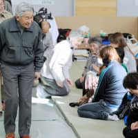 Emperor Akihito and Empress Michiko visit an evacuation shelter for victims of the March 2011 earthquake-triggered tsunami in Miyako, Iwate Prefecture, in May 2011. | KYODO