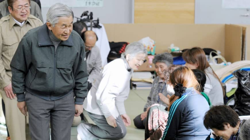 Emperor Akihito and Empress Michiko visit an evacuation shelter for victims of the March 2011 earthquake-triggered tsunami in Miyako, Iwate Prefecture, in May 2011.