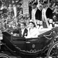 Crown Prince Akihito and Crown Princess Michiko parade through Tokyo on April 10, 1959, after they were married.  | KYODO