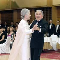 Emperor Akihito and Empress Michiko dance during a charity event at a Tokyo hotel on April 12, 2013. It was the first time in 20 years that the couple had danced in public. | POOL / VIA KYODO