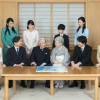Emperor Akihito and Empress Michiko are surrounded by their children and grandchildren in a family photo at the Imperial Palace on Dec. 3. | IMPERIAL HOUSEHOLD AGENCY / VIA KYODO