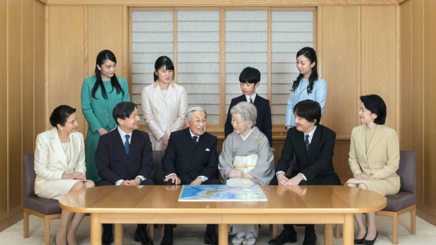 Emperor Akihito and Empress Michiko are surrounded by their children and grandchildren in a family photo at the Imperial Palace on Dec. 3.