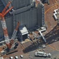 Tepco transfers first nuclear fuel out of No. 3 reactor building at crippled Fukushima plant