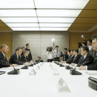 Ministers and other lawmakers meet Friday at the Prime Minister's Office to discuss measures against gambling addiction.   KYODO
