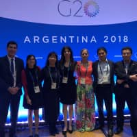 Yuka Iwatsuki (third from left) and other civil society leaders gather at the Group of 20 meeting in Argentina in December, where they presented their recommendations to Argentine President Mauricio Macri. | COURTESY OF ACE