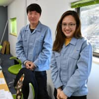 Parnward Manakul (right), a Thai employee at Atom Co., and Son Seung-hyeon, an intern from South Korea, pose for a photo at their office in Tokyo's Hachioji on Jan. 29. | Yoshiaki Miura