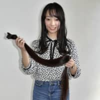 Japanese teenager lops off Guinness World Record-setting locks ready for Reiwa and college
