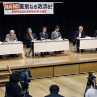 Lawyers for plaintiffs speak at a news conference in the city of Fukuoka on Monday after the Fukuoka High Court overturned a district court ruling and denied damages to chronic hepatitis B sufferers who contracted the illness in a state-run vaccination program. | KYODO