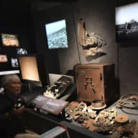 Artifacts from the 1945 atomic bombing of Hiroshima are shown to the media at the renovated Hiroshima Peace Memorial Museum on Wednesday, ahead of its public opening Thursday. | KYODO