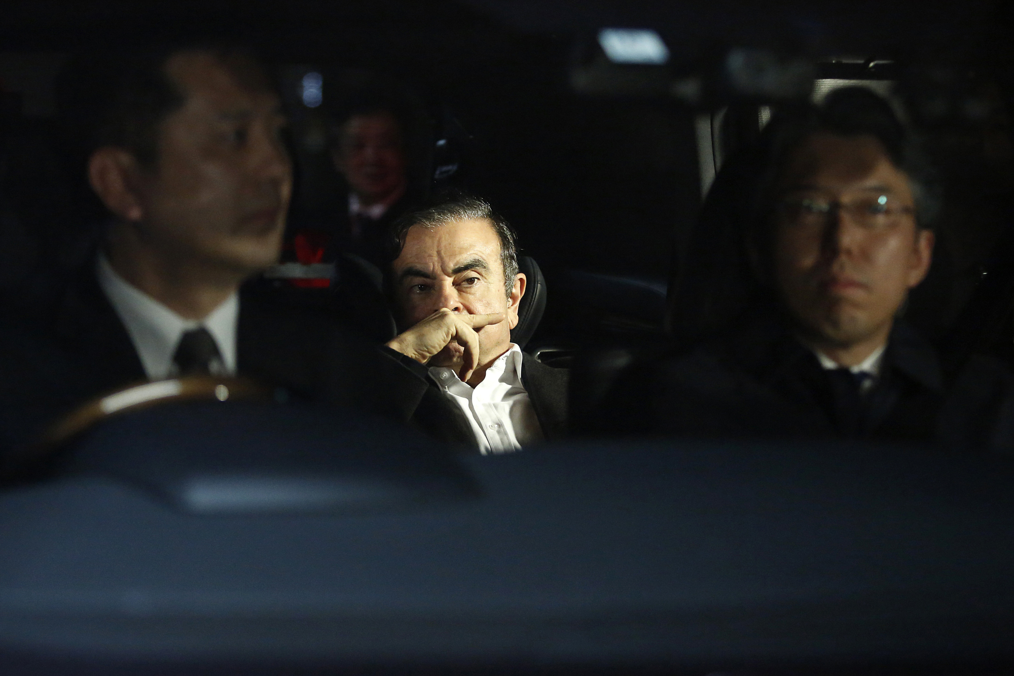 Carlos Ghosn, former chairman of Nissan Motor Co., leaves his lawyer's office in Tokyo on March 6 following his release from detention. He was rearrested April 4. | BLOOMBERG