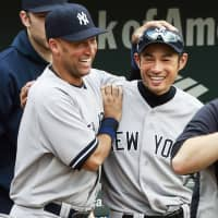 Ichiro shares a moment with Yankees teammate Derek Jeter after a victory in September 2012 in Baltimore. | KYODO