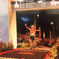 Hiromu Inada competes at the Ironman World Championship in Kailua-Kona, Hawaii, on Oct. 13. At 85, he became the oldest man to finish the race, which consists of a 3.86-kilometer swim, a 180.25-km bike and a full marathon. | COURTESY OF HIROMU INADA/KYODO