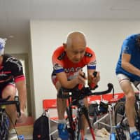 Hiromu Inada, an 86-year-old triathlete, trains on his bike at his gym in the city of Chiba on March 6. | KYODO