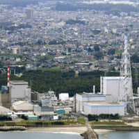 The Tokai No. 2 plant (right) operated by Japan Atomic Power Co. in Ibaraki Prefecture, is seen in this photo taken last July. | KYODO