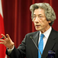 Then-Prime Minister Junichiro Koizumi speaks with reporters after calling a snap election in August 2005. | BLOOMBERG NEWS