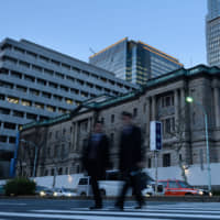 The Bank of Japan has gobbled up Japanese government bonds in the past several years, amassing a 43 percent share of the JGB market. | BLOOMBERG
