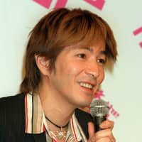 Musician and producer Tetsuya Komuro attends a news conference in Tokyo in May 2001. | KYODO
