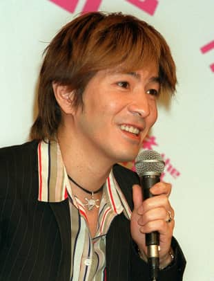 Musician and producer Tetsuya Komuro attends a news conference in Tokyo in May 2001.