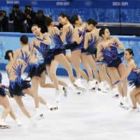 A time-elapsed photo shows figure skater Mao Asada performing a triple axel at the Sochi Olympics in February 2014. | KYODO