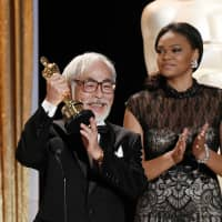 Animator Hayao Miyazaki receives an honorary award at the Academy of Motion Picture Arts and Sciences' Governors Awards in Los Angeles on Nov. 8, 2014. | REUTERS / VIA KYODO