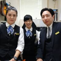 Yuko Nakajima (left), Mana Kikuchi (center) and Katsuji Mizusaki are nōkanshi, a term that refers to Japan's traditional morticians who dress and clean up the deceased. They work at Aqua Quality Staff Co., a Tokyo-based company Mizusaki founded a decade ago. | ALEX MARTIN