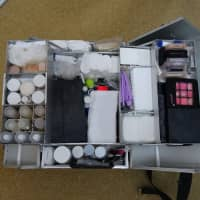 From lipstick and facial makeup to gauze, Aqua Quality Staff's custom-made container is filled with various items its morticians use to treat the dead before sending them off on their final journey. | ALEX MARTIN