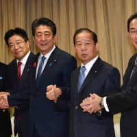Liberal Democratic Party heavyweight Toshihiro Nikai (second from right), Prime Minister Shinzo Abe and others are seen last October. | YOSHIAKI MIURA