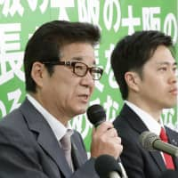Osaka leaders win in elections to swap roles, but merger prospects unclear