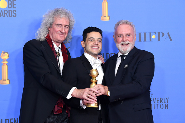 Oscar-winning actor Rami Malek, who played the role of Freddie Mercury in blockbuster movie 'Bohemian Rhapsody,' joins hands with Queen's Brian May and Roger Taylor at the 76th Annual Golden Globe Awards ceremony held in Beverly Hills, California, in January. | GETTY IMAGES