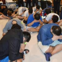 Thai police arrested 15 Japanese on suspicion of working without permission last month in Pattaya. The group is suspected of carrying out a phone scam targeting people in Japan. | KYODO