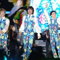 Members of the pervasive boy band SMAP perform at a concert in Beijing on Sept. 16, 2011. | AP