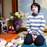 Taeko Watanabe, whose son, Yuki, committed suicide in 2008, talks in front of his portrait at her home in Akita Prefecture on Feb. 9. | REUTERS