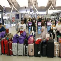 A line of suitcases is seen at Kansai International Airport's international departure lobby in September after it reopened following a typhoon. | KYODO