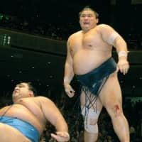 Yokozuna Takanohana reacts after winning against Musashimaru in the championship playoff on the last day of the Summer Grand Sumo Tournament in May 2001. Takanohana overcame a torn meniscus in his right knee, which he suffered two days before, to defeat the Hawaiian yokozuna in dramatic fashion.   KYODO