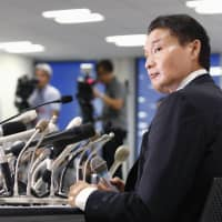 Stablemaster Takanohana speaks at a news conference after handing in his resignation to the Japan Sumo Association on Sept. 25 in Minato Ward, Tokyo.   KYODO