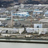 Tokyo Electric Power Company Holdings Inc. is turning to workers from overseas for decommissioning work at the Fukushima No. 1 nuclear power plant. | KYODO