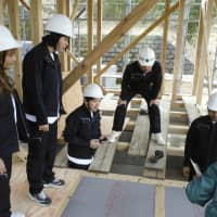 College students from Thailand learn about wooden architecture during their recent training in the village of Mitsue, Nara Prefecture. Thailand hopes to revive wooden architecture. | KYODO