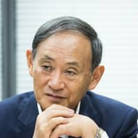 Japan's top government spokesman eyes U.S. trip in May to raise abduction issue