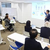 Number of people with disabilities working at Japanese firms tops 500,000 for first time