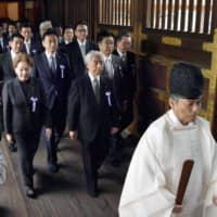 A cross-party group of lawmakers, headed by Hidehisa Otsuji of the Liberal Democratic Party, visits the controversial Yasukuni Shrine in Tokyo on Tuesday. | KYODO