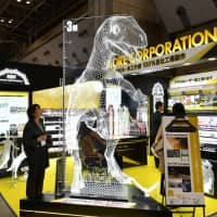 A hologram of a dinosaur is displayed at the Architecture and Construction Materials exhibition at Tokyo Big Sight on March 7. | YOSHIAKI MIURA
