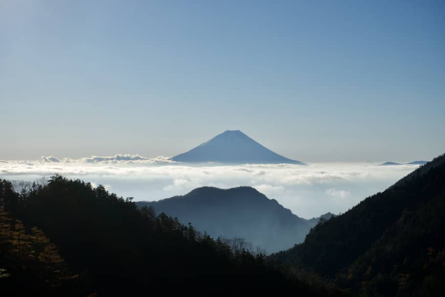Towering above the cloudline: A view of Mount Fuji from the trail to the summit of Mount Houou in the Southern Alps.