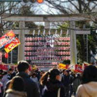 A crowd gathers: During festival periods at Okunitama Shrine, the shrine is decorated with hundreds of lanterns and visited by thousands of revellers. | GETTY IMAGES