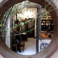 Find tranquility in the heart of a metropolis: Peeking into Ban She, a cafe occupying a restored lane house off Nanchang Road in Shanghai. | MATTHEW WALSH