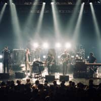 Touring lineup: Nine members of the Snarky Puppy ensemble play to a packed house on the Japan leg of the group's world tour. | OSCAR BOYD
