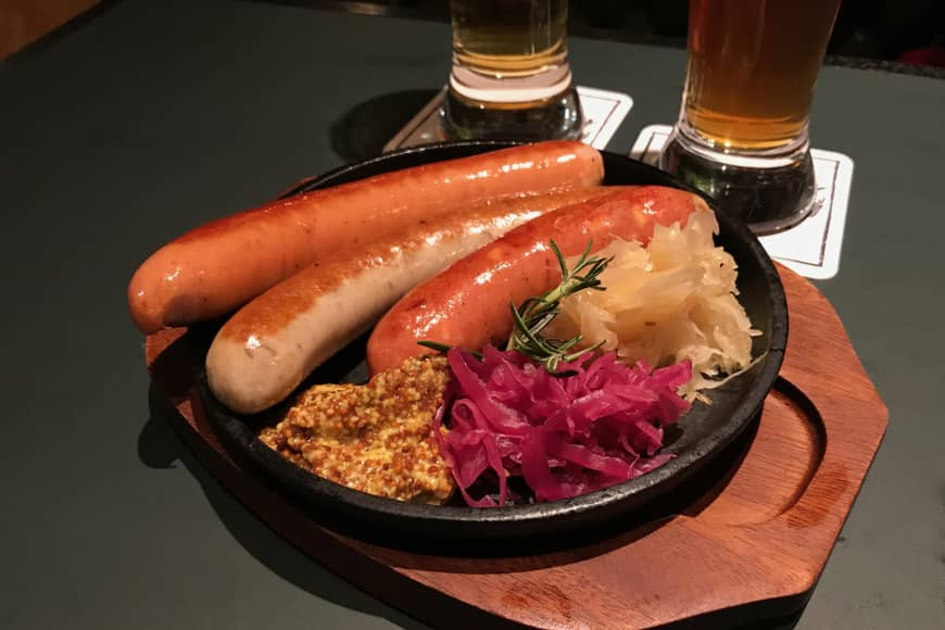 New location, better wurst: Schmatz has over half a dozen sausages on its menu, alongside classic German bar foods and locally brewed craft beer.